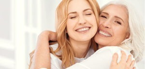 mom and daughter smiling and hugging