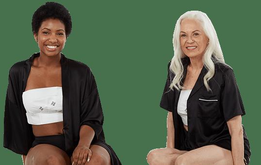 Two smiling women wearing EZBRA's and black pajamas