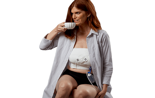Woman drinking coffee while wearing her EZBRA