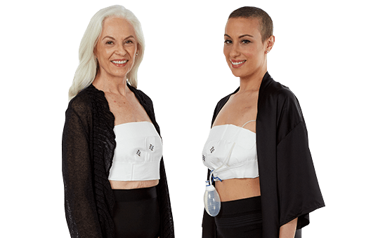 Two smiling women wearing EZBRA's and black pajamas