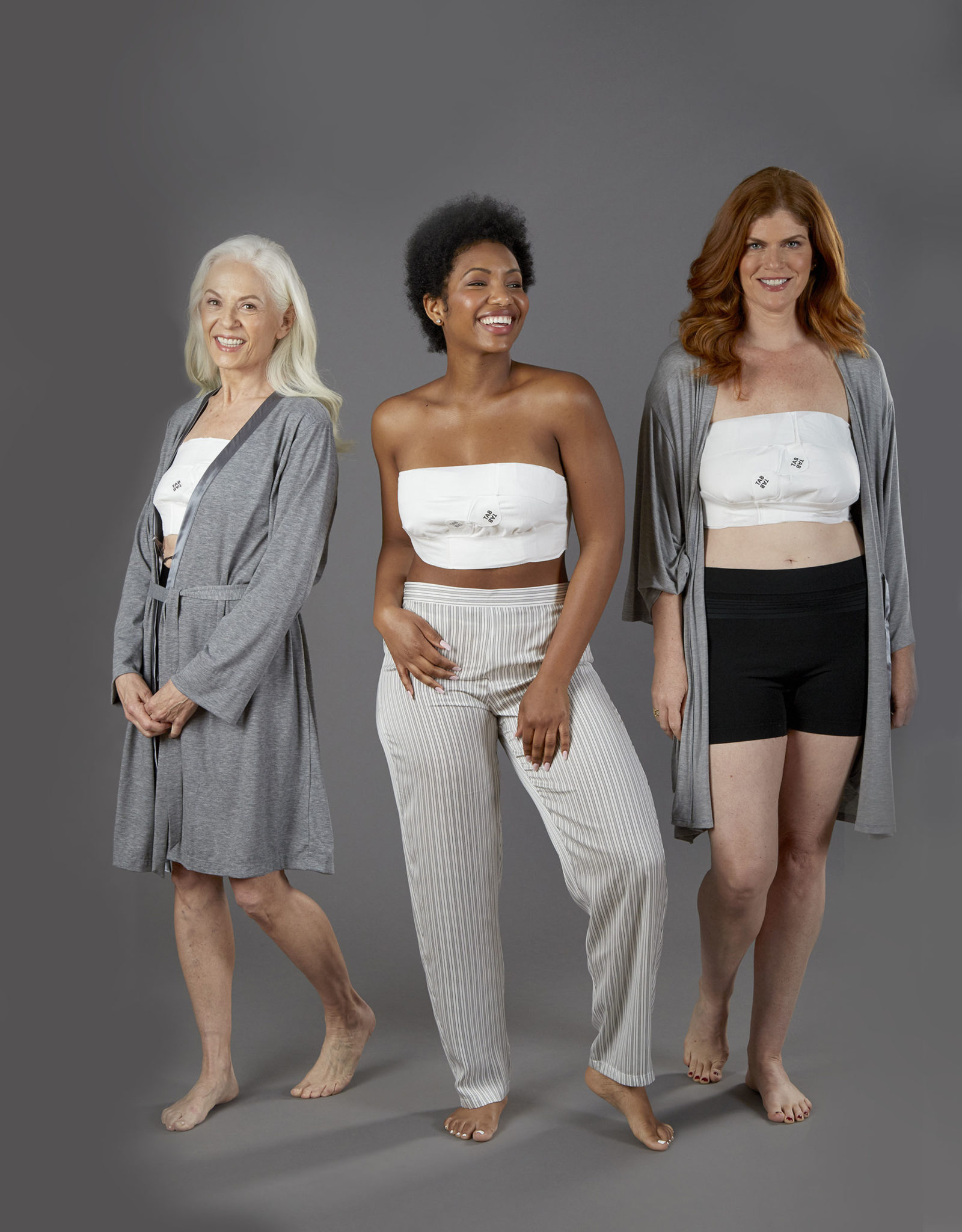 three women of different ages smiling while wearing their EZBRA